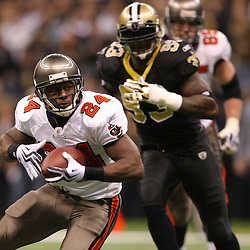 Dec 27, 2009; New Orleans, LA, USA; Tampa Bay Buccaneers running back Cadillac Williams (24) runs away from New Orleans Saints defensive end Bobby McCray (93) during the second quarter at the Louisiana Superdome. Mandatory Credit: Derick E. Hingle-US PRESSWIRE..