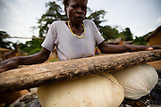A woman prepares attieke, a local staple made of cassava, in Tano Akakro, Cote d'Ivoire on Saturday June 20, 2009.