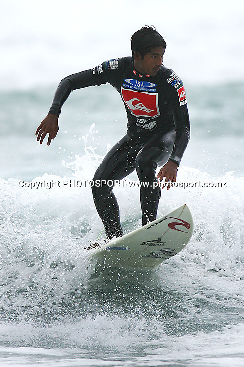 Hairil Anwar (IND) during Under 18 repercharge round. World Junior Surfing Championship, Day 3, Piha, New Zealand. Saturday 23rd January 2010. Photo: Anthony Au-Yeung/PHOTOSPORT