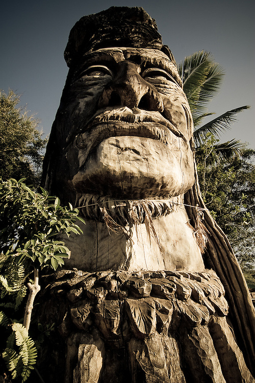 A wooden statue, Maui Pohaku Loa, stands tall at the north shore, Oahu, Hawaii, USA.