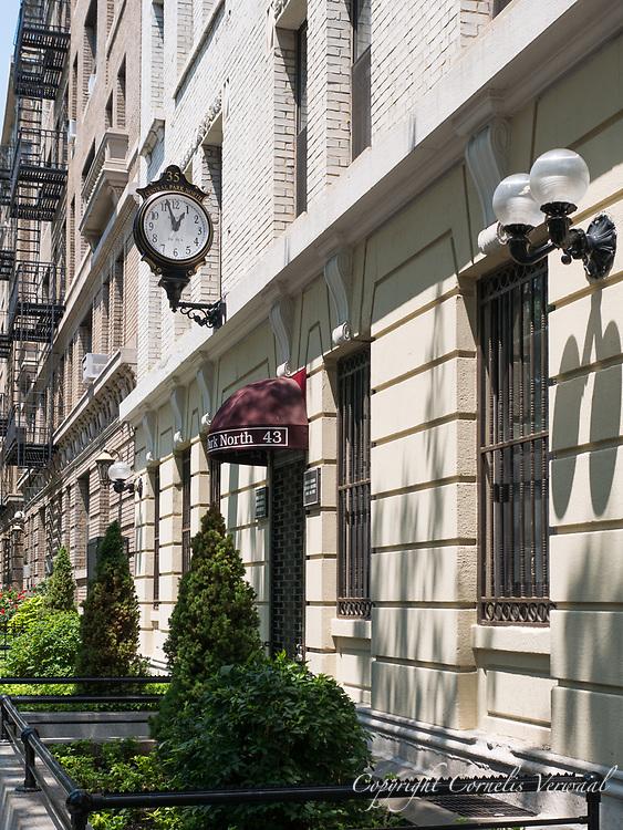 Street clock on 110th street (35 Central Park North)
