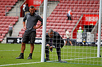 Football - 2016 / 2017 Premier League - Southampton vs. Swansea City<br /> <br /> A Southampton groundsman looks on as an official checks the goal line technology after the match at St Mary's Stadium Southampton  <br /> <br /> Colorsport/Shaun Boggust