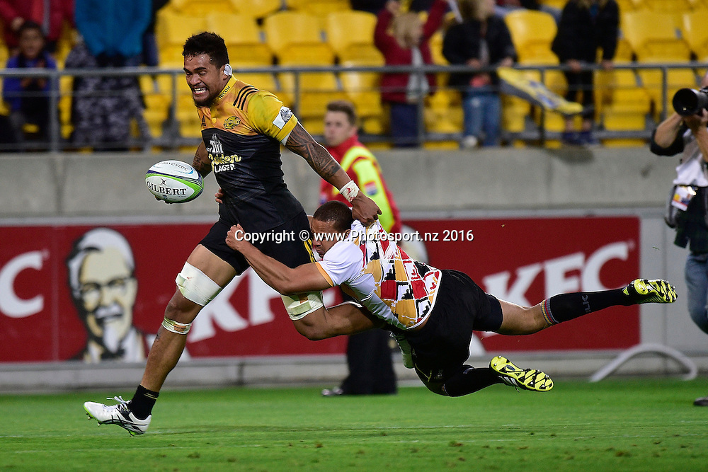 Vaea Fifita (L) of the Hurricanes is tackled by  Edgar Marutlulle of the Southern Kings during the Hurricanes vs Kings Super Rugby  match at the Westpac Stadium in Wellington on Friday the 25th of March 2016. Copyright Photo by Marty Melville / www.Photosport.nz