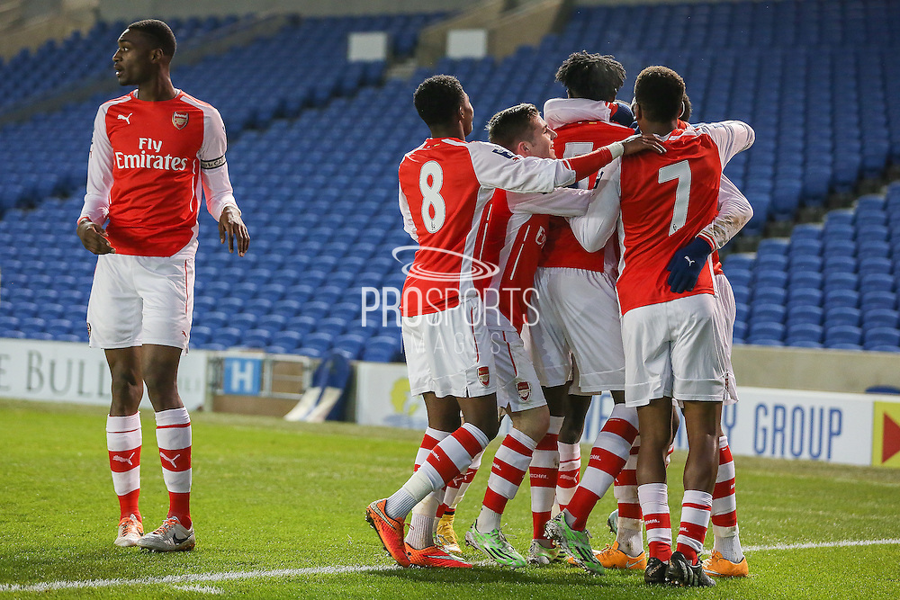 Arsenal players celebrate Arsenal's Chuba Akpom goal during the Barclays U21 Premier League match between Brighton U21 and Arsenal U21 at the American Express Community Stadium, Brighton and Hove, England on 1 December 2014.