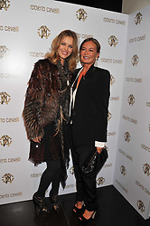 Left to right, EVA HERZIGOVA and EVA CAVALLI  at a party hosted by Roberto Cavalli to celebrate his new Boutique's opening at 22 Sloane Street, London followed by a party at Battersea Power Station, London SW8 on 17th September 2011.