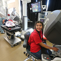 Ayleen Garcia, 14, from Guntown Middle School plays with the da Vinci XI surgical system to manipulate the four arms located behind her.