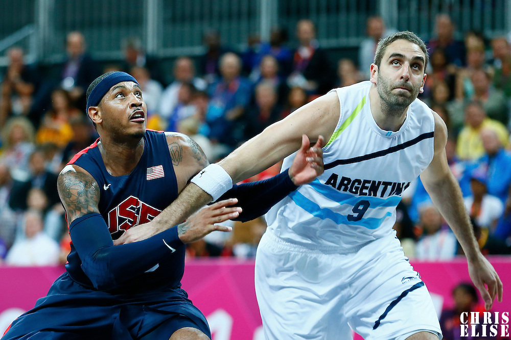06 August 2012: USA Carmelo Anthony vies for the rebound with Argentina Juan Pedro Gutierrez during 126-97 Team USA victory over Team Argentina, during the men's basketball preliminary, at the Basketball Arena, in London, Great Britain.