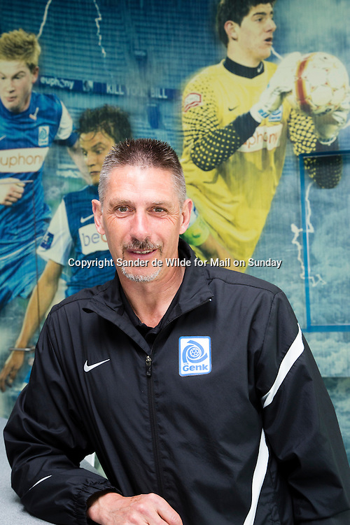 portrait of goalkeeping coach Gilbert Roux at KRC Genk, who coached Thibaut Courtois who is a goalkeeper for Atletico Madrid, on loan from Chelsea. A big photowall with Courtois in the background, at the cafetaria