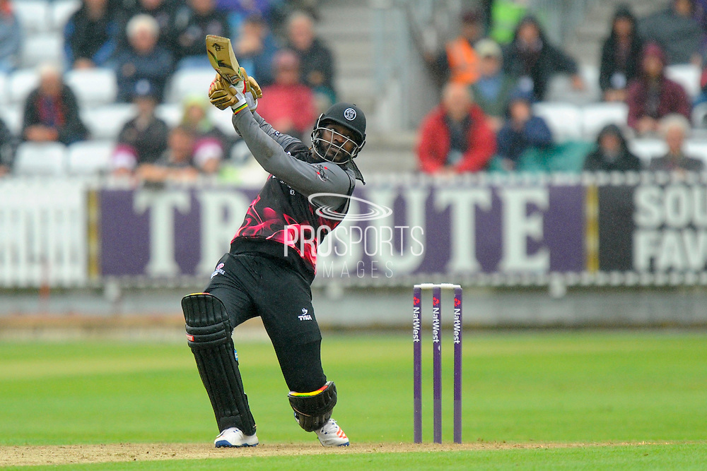Somerset's Chris Gayle hits a six during the NatWest T20 Blast South Group match between Somerset County Cricket Club and Hampshire County Cricket Club at the Cooper Associates County Ground, Taunton, United Kingdom on 19 June 2016. Photo by Graham Hunt.