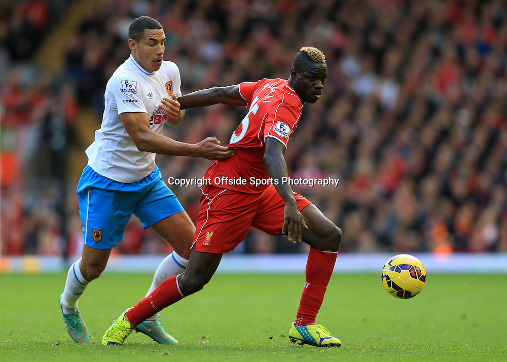 25th October 2014 - Barclays Premier League - Liverpool v Hull City - Jake Livermore of Hull holds back Mario Balotelli of Liverpool - Photo: Simon Stacpoole / Offside.