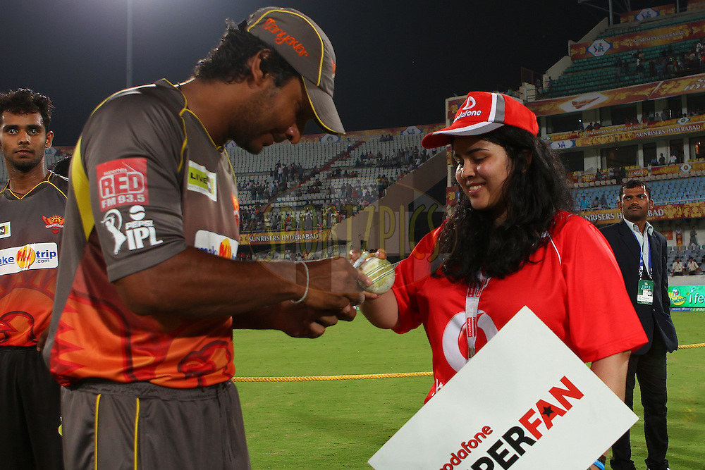 Kumar Sangakkara signs the match ball for the Vodafone Superfan during match 7 of the Pepsi Indian Premier League between The Sunrisers Hyderabad and Royal Challengers Bangalore held at the Rajiv Gandhi International  Stadium, Hyderabad  on the 7th April 2013..Photo by Ron Gaunt-IPL-SPORTZPICS   ..Use of this image is subject to the terms and conditions as outlined by the BCCI. These terms can be found by following this link:..http://www.sportzpics.co.za/image/I0000SoRagM2cIEc