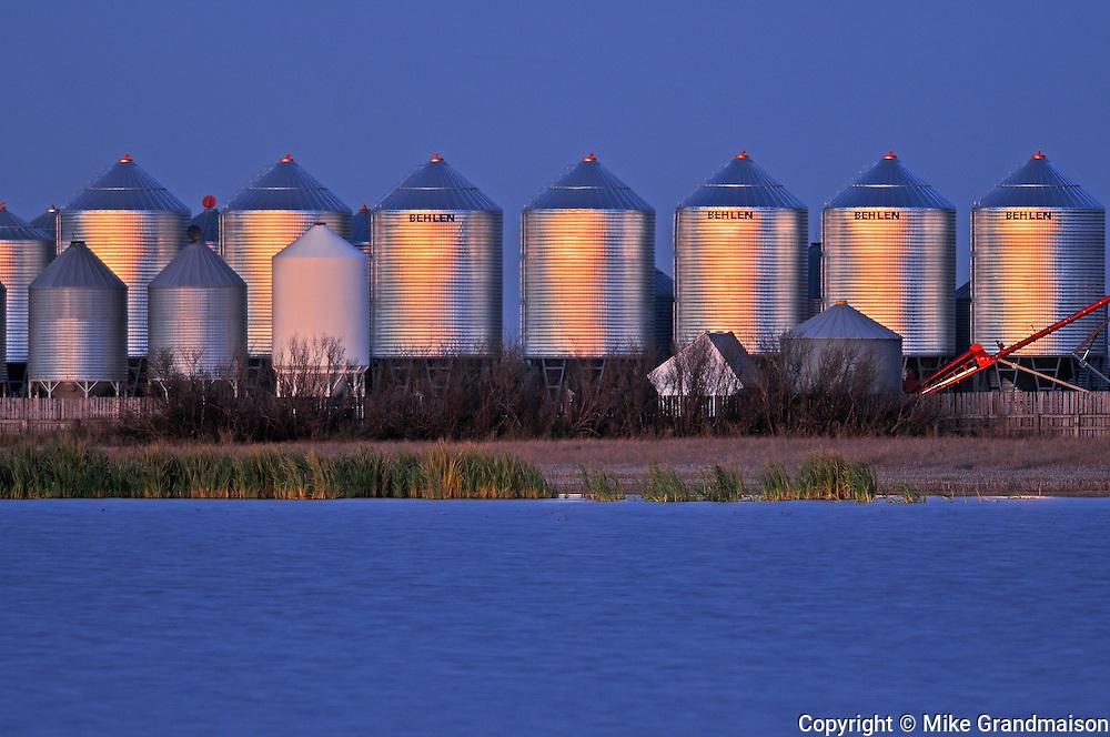 Grain bins at dusk<br /> Tuxford<br /> Saskatchewan<br /> Canada