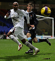 Photo: Paul Thomas.<br /> Bolton Wanderers v West Ham United. The Barclays Premiership. 09/12/2006.<br /> <br /> El Hadji Diouf (L) of Boton controle the ball past Jonathan Spector of West Ham.