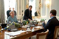 05 JUN 2010, GRANSEE/GERMANY:<br /> Angela Merkel (L), CDU, Bundeskanzlerin, Christoph Heusgen (M), Leiter Abteilung 2 (Außenpolitik) im Bundeskanzleramt, und Dimitri Medwedew (R), Praesident Russische Foerderation, vor einem Gespraech, Gaestehaus der Bundesregierung Meseberg<br /> IMAGE: 20100605-01-007