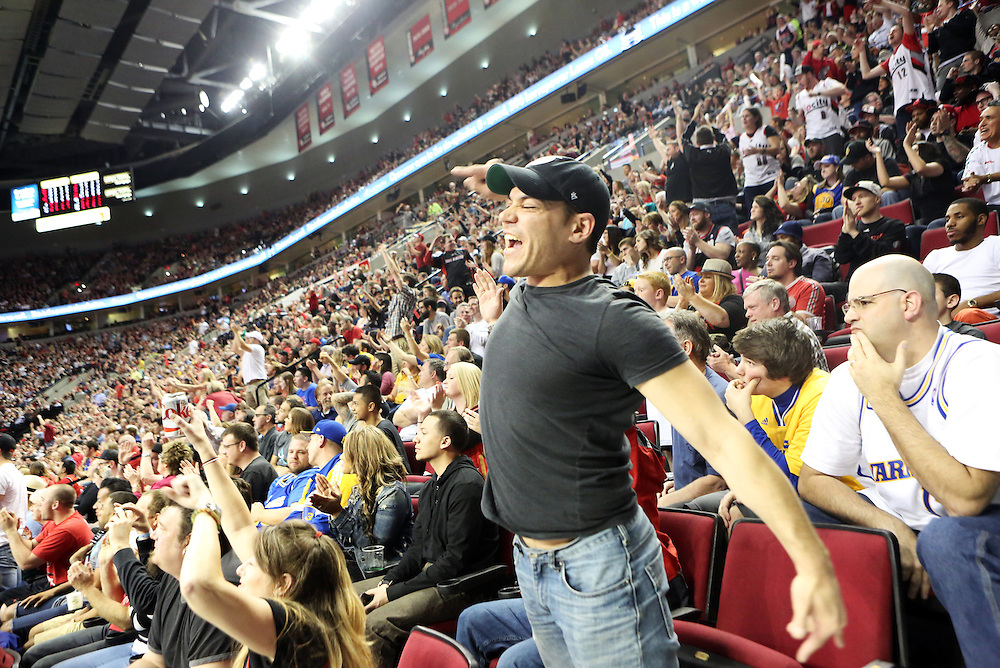 Alberto Escobar cheers an exciting game at the Moda Center arena as the Portland Trailblazers host the Golden State Warriors in an National Basketball Association game in Portland, Ore.