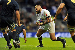 Joe Marler (England) in possession - Photo mandatory by-line: Patrick Khachfe/JMP - Tel: Mobile: 07966 386802 09/11/2013 - SPORT - RUGBY UNION -  Twickenham Stadium, London - England v Argentina - QBE Autumn Internationals.