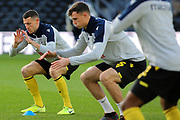 Millwall players in the pre-match warm up during the EFL Sky Bet Championship match between Derby County and Millwall at the Pride Park, Derby, England on 14 December 2019.