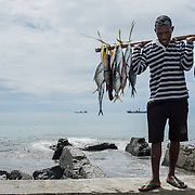 Fishermen selling fish in the streets of Dili, capital of Timor-Leste