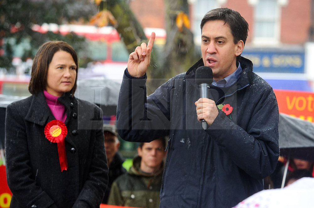 © Licensed to London News Pictures. 09/11/2013 London, UK. Labour party leader Ed Miliband makes a speech in torrential rain during a constituency visit in support of  Labour prospective parliamentary candidate for Hornsey and Wood Green, Catherine West. Photo credit : Simon Jacobs/LNP