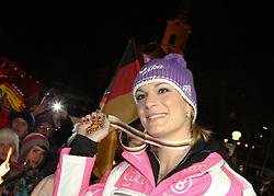 08.02.2013, DSV WM- Treff, Haus im Ennstal, AUT, FIS Weltmeisterschaften Ski Alpin, Schladming, im Bild Goldmedailllen Gewinnerin Maria Hoefl- Riesch (GER) vor der Kirche Haus im Ennstal // Maria Hoefl- Riesch of Germany poses with her Gold Medal in front of the church of Haus im Ennstal during FIS Ski World Championships 2013 at the DSV WM- Treff, Haus im Ennstal, Austria on 2013/02/08. EXPA Pictures © 2013, PhotoCredit: EXPA/ Martin Huber.