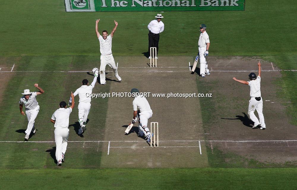 Tim McIntosh takes a catch to dismiss Mitchell Johnson off the bowling of Vettori.<br />Test Match Cricket. 2nd test. Day 1.<br />New Zealand Black Caps versus Australia. Seddon Park, Hamilton, New Zealand. Saturday 27 March 2010. <br />Photo: Andrew Cornaga/PHOTOSPORT
