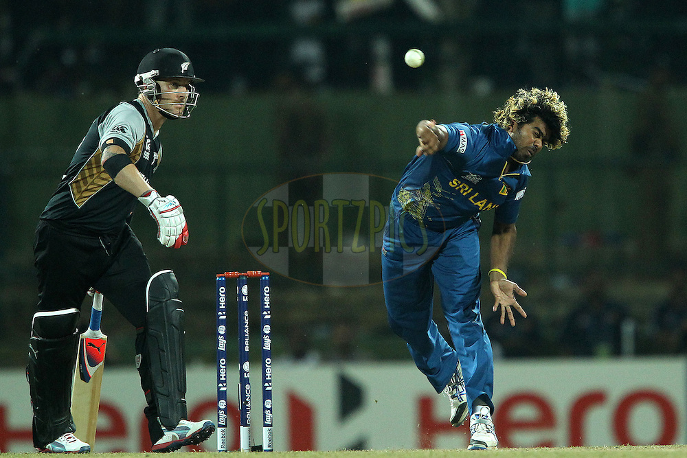 Lasith Malinga bowls in the super over during the ICC World Twenty20 Super 8s match between Sri Lanka and New Zealand held at the  Pallekele Stadium in Kandy, Sri Lanka on the 27th September 2012..Photo by Ron Gaunt/SPORTZPICS/PHOTOSPORT