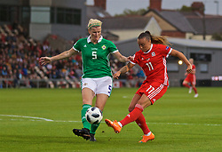 NEWPORT, WALES - Tuesday, September 3, 2019: Wales' Natasha Harding shoots under pressure from Northern Ireland's Julie Nelson during the UEFA Women Euro 2021 Qualifying Group C match between Wales and Northern Ireland at Rodney Parade. (Pic by David Rawcliffe/Propaganda)