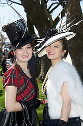 LIVERPOOL, ENGLAND, Thursday, April 7, 2011: Mother and daughter Lay and Mimi (R) during Ladies' Day on Day Two of the Aintree Grand National Festival at Aintree Racecourse. (Photo by David Rawcliffe/Propaganda)