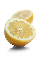 Halved lemon on white background