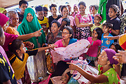 Villagers distribute donate clothes.  1500 people were displaced and found shelter in Langaoge coconut farm when a powerful  7.5 earthquake magnitude struck off the coast of Donggala (epicentre) Central Sulawesi, Indonesia on Sept. 28th causing a tsunami and destroying many homes.