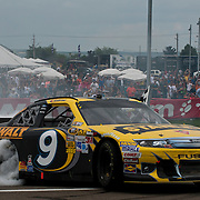 August 12, 2012:  Sprint Cup Series driver Marcos Ambrose (9) wins and does a burnout at  the Finger Lakes 355 at the glen at Watkins Glen International speedway, Watkins Glen, New York.  (Credit Image: © Kostas Lymperopoulos/Cal Sport Media)