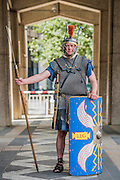 A legionary officer stands guard at the gates - Gladiators gather on the site of London's only performers that worked on Ridley Scott's Gladiator film will clash on the spot where gladiators battled 2,000 years ago in the courtyard of the Guildhall. Ten public evening and matinee performances will take place on selected dates between 8 and 16 August. Full information and tickets at www.museumoflondon.org.uk<br /> <br /> <br /> Hidden for centuries, the ancient remains of London's Roman amphitheatre were discovered by archaeologists in 1988. They are open for viewing all year. The Gladiator Games are performed by Britannia, renowned for its work on the Ridley Scott film, Gladiator. Each performance is the result of research into events in the 1st century A.D., using images drawn from Roman coins, paintings, sculpture and mosaics.