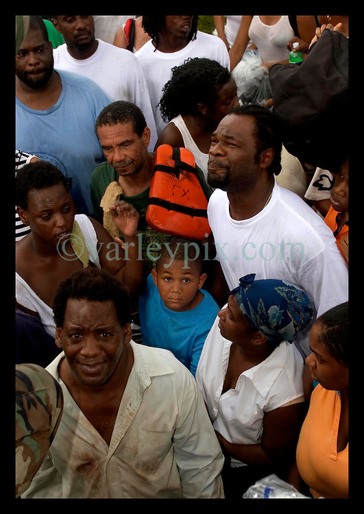 30th August, 2005. Aftermath of Hurricane Katrina, New Orleans, Louisiana. Desperation on the faces of the newly homeless as they plead for space on army transport to get them out of the lower 9th ward.