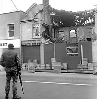 McGleenan's Bar, English Street, Armagh, N Ireland, where the publican, John McGlennan, 45 years, married, 5 children, Roman Catholic, died in a UVF shooting and bomb attack the previous evening. A customer, Patrick Hughes, also died in the incident. 197508220610a<br /> <br /> Copyright Image from Victor Patterson, 54 Dorchester Park, Belfast, United Kingdom, UK.  Tel: +44 28 90661296; Mobile: +44 7802 353836; Voicemail: +44 20 88167153;  Email1: victorpatterson@me.com; Email2: victor@victorpatterson.com<br /> <br /> For my Terms and Conditions of Use go to http://www.victorpatterson.com/Terms_%26_Conditions.html