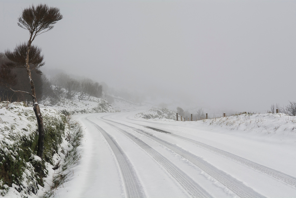 Snow blankets the Summit Road on the Port Hills, Christchurch, New Zealand, Wednesday, July 12, 2017. Credit:  SNPA / David Alexander
