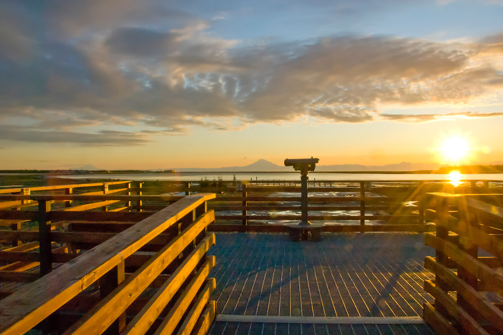 Observation deck overlooking the Kenai River, Cook Inlet, and volcanoes of the Alaska Range at sunset.