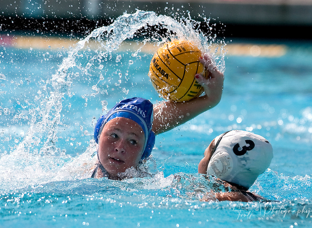/Andrew Foulk/ For The Californian/ .Temescal Canyon's Lauren Thatcher, readies her self for a shot as Bonita's Jayne Reimel, tries to block during the CIF Southern Section Division V girls water polo championship match.