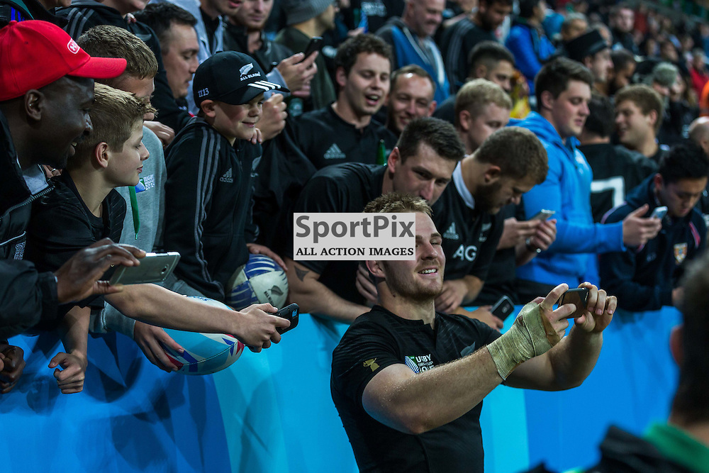 Sam Cane takes a selfie with fans after the Rugby World Cup match between New Zealand and Tonga (c) ROSS EAGLESHAM | Sportpix.co.uk