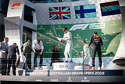 March 17, 2019 - Albert Park, VIC, U.S. - ALBERT PARK, VIC - MARCH 17: Champagne flies with Lewis Hamilton, Valtteri Bottas and Max Verstappen on the podium at The Australian Formula One Grand Prix on March 17, 2019, at The Melbourne Grand Prix Circuit in Albert Park, Australia. (Photo by Speed Media/Icon Sportswire) (Credit Image: © Steven Markham/Icon SMI via ZUMA Press)