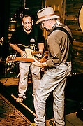 Woody Jenkins and David Joel Edmisten (facing) while performing with Rusty Lemmon at The Smokin' Tuna in Key West, FL.