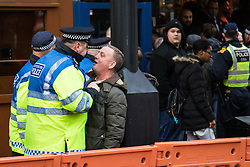 London, November 6th 2016. A police officer confronts a man outside a pub after the North London Derby between Arsenal FC and Tottenham Hotspur, that ended in a 1-1 draw.