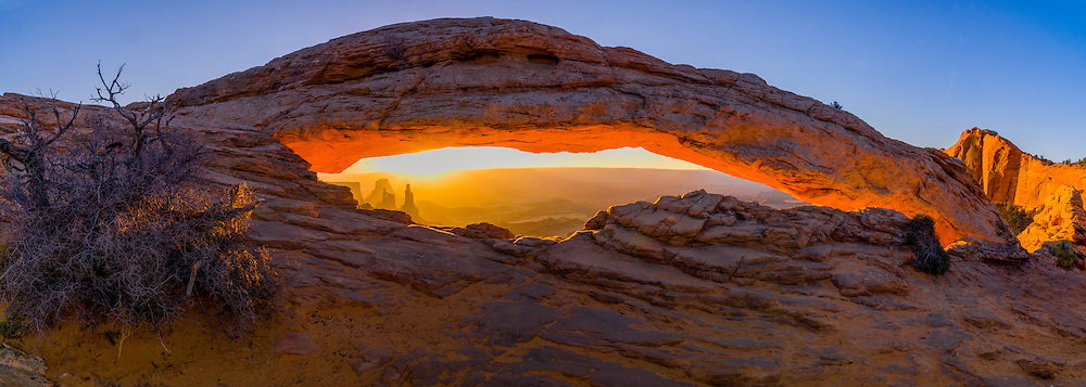 Mesa Arch spans the horizion above the White Rim Trail in Canyonlands National Park, Utah.