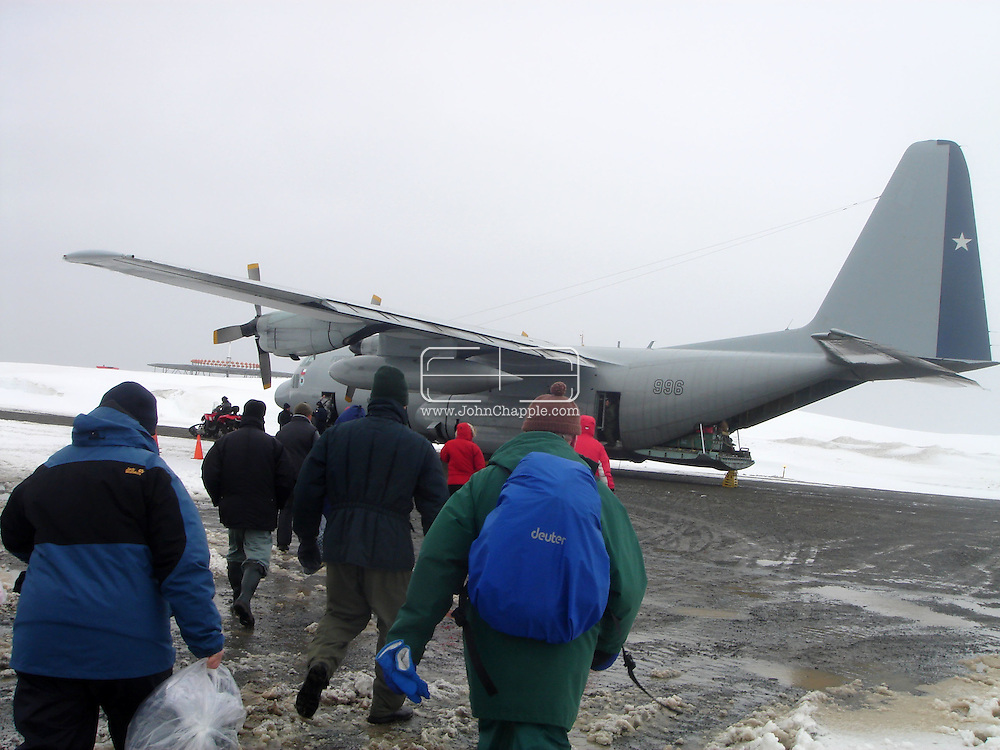 """24th November 2007, Punta Arenas, Chile. Survivors from the shipwrecked Antarctic vessel M/S Explorer arrive at Punta Arenas by military aircraft. 154 tourists and crew had spent the night on King George Island after their ship struck an iceberg and sank approximately 120km (75 miles) north of the Antarctic Peninsula. After several hours bobbing in small lifeboats surrounded by floating sheets of ice, they were plucked to safety by the Norwegian cruise ship, the Nordnorge. The """"Spirit of Shackleton"""" 19-day cruise through the Drake Passage, cost from around $8,000 (£3,900) per cabin. Pictured is the Hercules aircraft containing the ships passengers..PHOTO SUPPLIED BY REBEL IMAGES.john@chapple.biz   www.chapple.biz"""