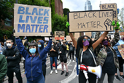 © Licensed to London News Pictures. 07/06/2020. London, UK. Protesters take part in a demonstration in outside the US Embassy organised by group Black Lives Matter for the American George Floyd who died whilst being arrested by US policemen Derek Chauvin. His death has caused civil unrest in some US cities. Photo credit: Ray Tang/LNP