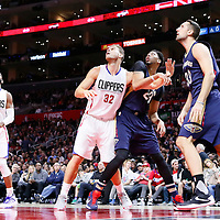 27 November 2015: Los Angeles Clippers forward Blake Griffin (32) vies for the rebound with New Orleans Pelicans forward Anthony Davis (23) next to New Orleans Pelicans forward Ryan Anderson (33) and Los Angeles Clippers guard Chris Paul (3) during the Los Angeles Clippers 111-90 victory over the New Orleans Pelicans, at the Staples Center, Los Angeles, California, USA.