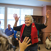 MANASSAS, VA - NOV21: Sandra Boletchek dances during karaoke at Birmingham Green, an elder care residence in Manassas, VA, November 21, 2014. With the U.S. population aging and Alzheimer's more widespread, science is looking for ways to slow or delay the onset of dementia in aging Americans. Among the approaches is trying to determine whether art, music and dance or movement can also alleviate the problems attendant with dementia. The federal government is funding a study at Birmingham Green with George Mason University to see whether there is a scientific basis to believe that art is actually medically beneficial. (Photo by Evelyn Hockstein/For The Washington Post)