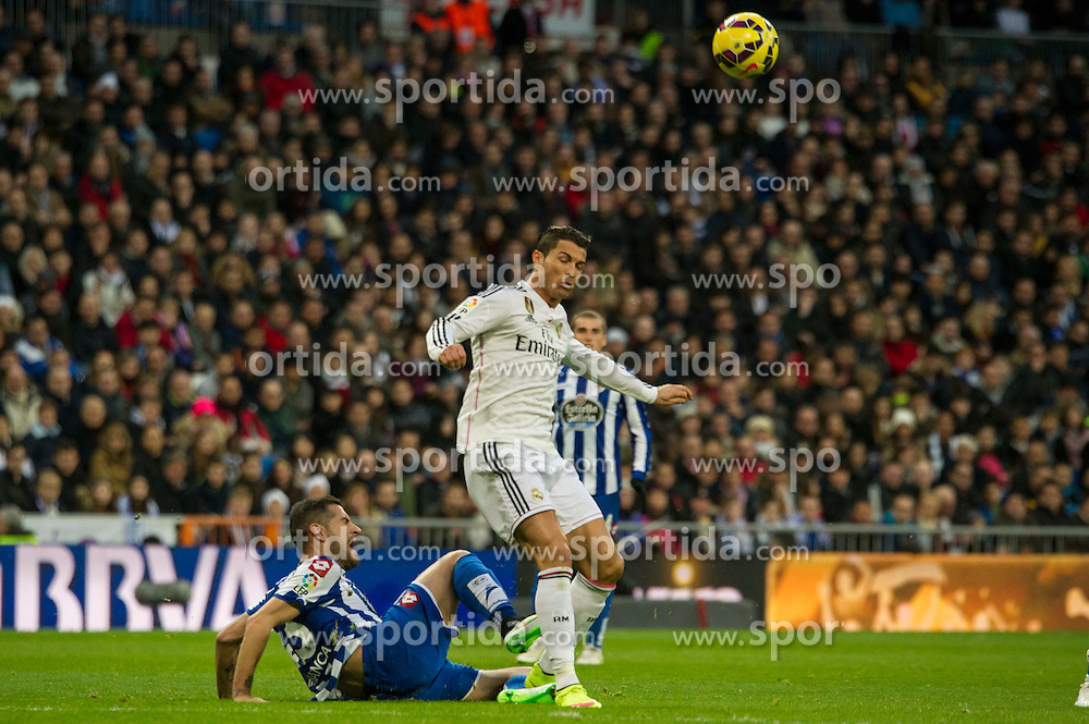 14.02.2015, Estadio Santiago Bernabeu, Madrid, ESP, Primera Division, Real Madrid vs Deportivo La Coruna, 23. Runde, im Bild Real Madrid&acute;s Cristiano Ronaldo and Deportivo de la Coruna's Albert Lopo // during the Spanish Primera Division 23rd round match between Real Madrid vs Deportivo La Coruna at the Estadio Santiago Bernabeu in Madrid, Spain on 2015/02/14. EXPA Pictures &copy; 2015, PhotoCredit: EXPA/ Alterphotos/ Luis Fernandez<br /> <br /> *****ATTENTION - OUT of ESP, SUI*****