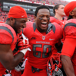 10 November 2012: Rutgers Scarlet Knights running back Savon Huggins (28) and Rutgers Scarlet Knights linebacker Quentin Gause (50) celebrate their victory during NCAA college football action between the Rutgers Scarlet Knights and Army Black Knights at High Point Solutions Stadium in Piscataway, N.J.. Rutgers defeated Army 28-7.