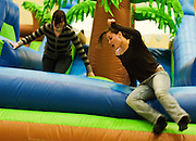 Ohio sophomore Kate Mussey races her sister Kori to the finish like on the inflatable obsticale course at Ping Fest during Sibs Weekend.