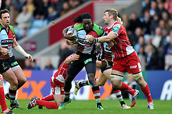 Harlequins replacement Paul Sackey is double-tackled - Photo mandatory by-line: Patrick Khachfe/JMP - Tel: Mobile: 07966 386802 12/10/2013 - SPORT - RUGBY UNION - Twickenham Stoop - London - Harlequins V Scarlets - Heineken Cup